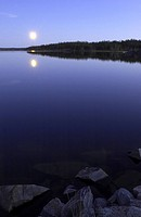 Early October moonrise over Pontoon Lake, which is located down the Ingraham Trail in Northwest Territories, Canada