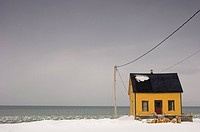 Little house, winter, Atlantic sea front in Rocher, Perce, Quebec
