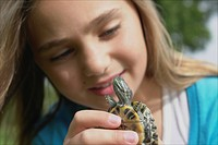Eight year old girl holding turtle, Winnipeg, Canada