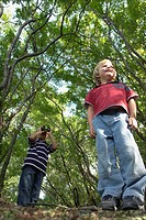 Four and six year old brothers on walking trail in forest, Winnipeg, Canada