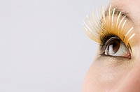 Young woman wearing long false eyelash