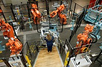 Operator, Volvo component factory and robot cells from ABB, car manufacturing, Olofström, Sweden