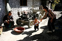Baima Tibetan couple teaching toddler how to walk, Pingwu County, Mianyang, Sichuan Province, China