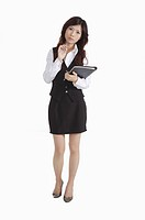 Young female office worker with clipboard