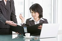 Businesswoman looking at document folder