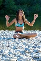 Teenage girl nature yoga