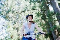 Woman bike riding in remote area