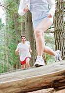 Couple running in forest