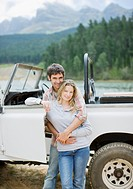 Couple hugging near jeep