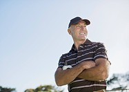 Golfer with arms crossed