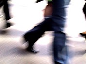 Business legs walking.Blurred to suggest movement.Silhouetted dream like lighting.Shot July Melbourne 2002.,Agent 109 Ewing