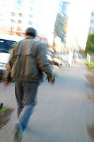 A man fleeing.Could suggest a crime.agent 109 Ewing