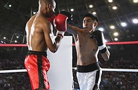 Two boxers fighting in Boxing ring (thumbnail)