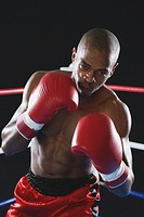African boxer wearing red Boxing gloves