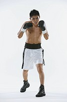 Japanese boxer with Boxing gloves in studio