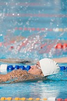 Swimmer doing backstroke in competition
