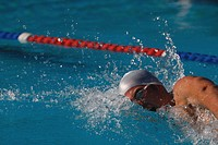 Young australian swimmer doing front crawl stroke
