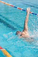 Young Australian swimmer doing backstroke