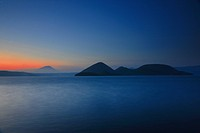Beautiful seascape with mountains at sunset
