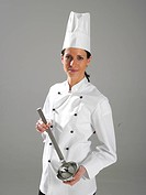 Junge Koechin mit Suppelkelle, young cook holds a dipper