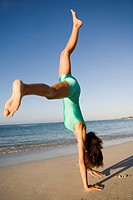 Woman beach gymnastics.