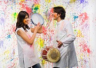 Couple playing musical instruments and smiling