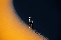 Rear view of woman walking in sand dune, Gobi Desert, Independent Of Mongolia