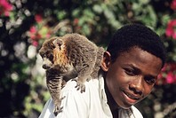 boy with lemur, comoros, africa