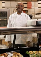 African man working at deli counter in grocery store