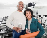 African couple standing in health club (thumbnail)