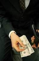 A businessman paying cash