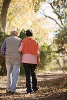 Hispanic couple walking in park