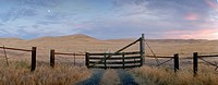 Gate near country road, California, USA