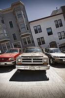 Crooked houses on a San Francisco hill and the cars perfectly parked, California, USA