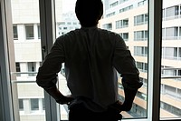 Businessman standing at window
