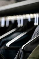 Close up of clothes on hangers