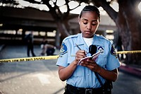 African policewoman writing in notebook (thumbnail)