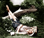 Woman lying on the ground and smiling Old Visuals