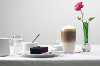 Chocolate brownie and coffee on table