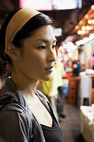 Asian woman in outdoor market