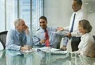 Business people discussing document in meeting
