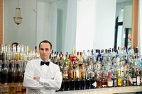 A bar tender standing at the bar