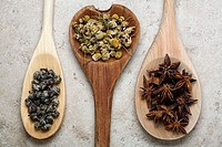 Herbs and spices on wooden spoons