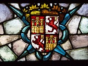 Glass with the shield of Castile and Leon in the Alcazar of Segovia, quartered crosswise with two castles of gold and two rampant lions, and stamped w...