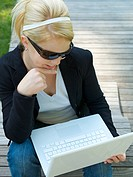 Businsswoman with Laptop in teh park