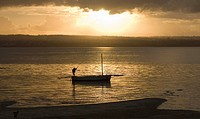 Fisherman returning to shore at sunset in Mozambique.
