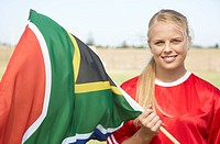 Woman smiling waving South African flag. Cape Town, Western Cape Province, South Africa