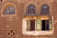 Kawkaban Yemen Close Up Of Stained Glass Windows And Shutters On Building