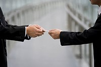 Two businessman exchanging business cards
