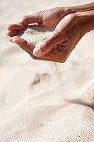 Woman hands sand